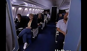 Juli Ashton copulates ginger linn in an airplane
