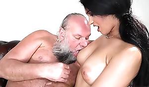 Pretty brunette with big naturals bonks an elderly man
